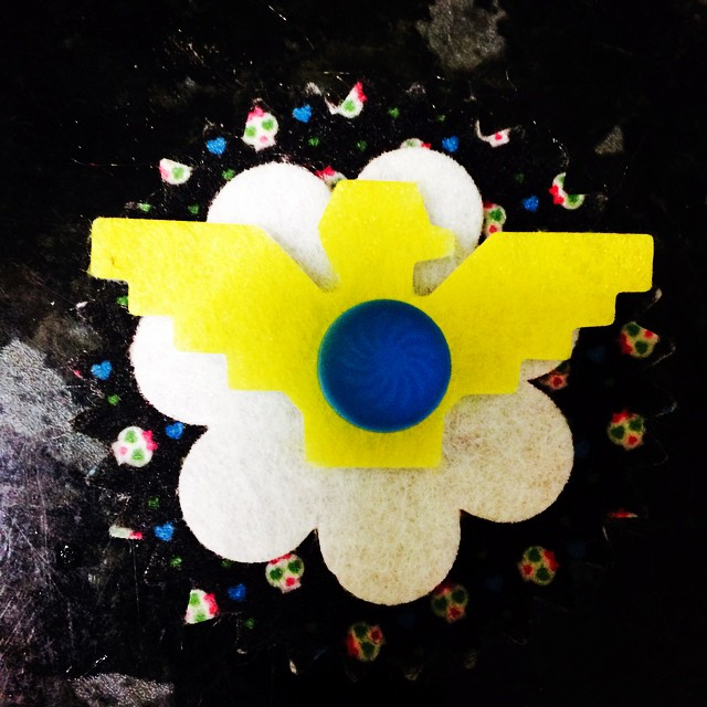Is it just me, or is that yellow layer on Edith's Bloom Pop a little bit...erm...Third Reich-y?