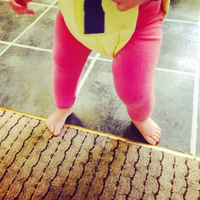 BB is in her door bouncer and the floor surface changes between rooms. I'm about 98% certain I just caught her hanging dribble onto the tiles so she could slide about in it with her feet. #grimchild